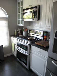Maybe a similar layout for our kitchen? Open up the space under the window