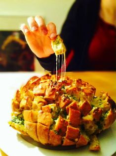 Tear and Share Recipe — Bloomin Onion Bread recipe is from Siktwinfood. You start with a loaf of bread that's already been made. Slice in a grid pattern – but not all the way through -then pour on the savory cheese, herb and onion mixture.