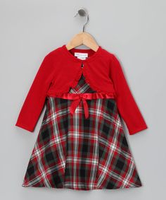 Let girls be girls in this number featuring a stylish high-waist ribbon and classic plaid pattern. Dress it up or down with tights and accessories. Every little girl deserves to own at least one dress that makes her feel fancy.Includes dress and boleroDress: 65% polyester / 35% rayonBolero: 67% polyester / 28% rayon / 5% spandexLining: 100% polyesterMachine wash; hang dryMade in the Philippines