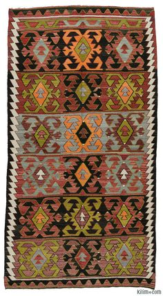 Vintage Turkish kilim rug around 40 years old and in very good condition. This rug was hand-woven in the Konya region of Central Anatolia, Turkey.