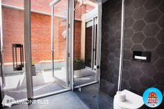 Kyal and Kara's bathroom and terrace The Block Glasshouse, Kyal And Kara, Laundry In Bathroom, Bathroom Stuff, Bathroom Ideas, Beaumont Tiles, Glass House, Terrace, Indoor