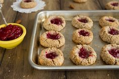 raspberry almond thumbprint cookies (gluten free and vegan)  almonds, brown rice flour, flaxseed meal, almond butter, maple syrup, raspberry jam, coconut...