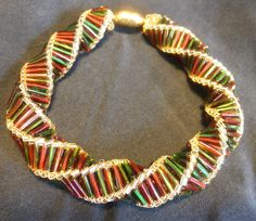 Gorgeous holiday beadwork bracelet in red, geen, and gold. $30.00, via Etsy.