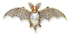 A pearl, diamond, enamel, ruby, silver and gold brooch in the form of a bat; in the West, the bat is a symbol of the night and dark forces. (Christie's)