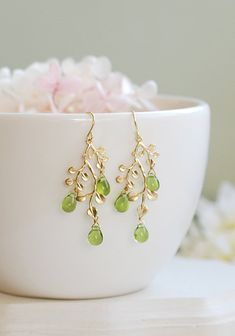 Hey, I found this really awesome Etsy listing at https://www.etsy.com/listing/241664597/peridot-green-earrings-gold-leaf