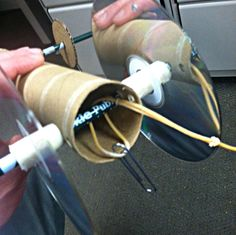 Rubberband Cars - Use milk jug/bottle caps as wheels, and TP roll, clothes pin, egg carton, or whatever for the car body - so many different ways to make one. Look up more posts. Stem Projects, Projects For Kids, Science Projects, Engineering Projects, School Projects, Craft Projects, Teen Programs, Library Programs, Stem For Kids