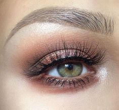 Bronzed eye look with amazing lashes.