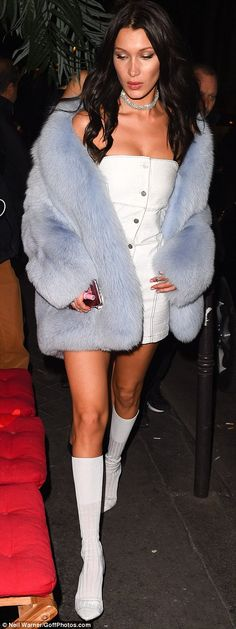 Thigh's the limit! The Calabasas socialite was joined by her fellow supermodel Bella, who paired her white mini-dress with a blue fur coat and diamond collar