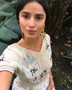 embroidered dress./ also dude HOW BEAUTIFUL is she like get out of here stop w/ your perfect dress and eyebrows already...