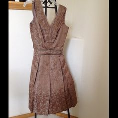 Ellie Tahari Silk Brocade Dress.  NWT size 6 SALE Special Occasion New Silk Brocade dress with Bronzed Chain Accent on Belt. Very beautifully made with silk lining and slightly ruffled attached slip. Lot of problems with lighting. This dress is a soft light taupe color. I will try pics again soon. Ellie Tahari Dresses