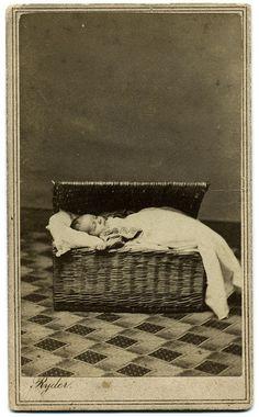Post mortem of infant in basket by Ron Coddington, via Flickr