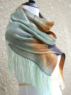 """Hand woven long scarf with gradually changing colors from white to orange, black and light mint. Amazing color shades and color variety. Measures: L: 78"""" with 6"""" fringe on ... #kgthreads #accessories #cozy #fall #fashion #gift #gradient #unisex #women #wrap"""
