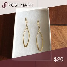 Gold Oval Hanging Earrings Gold Oval Hanging Earrings. Worn only once to a wedding. Beautiful. Comes in original box. Purchased at Macy's in Herald Square NYC 🚭 Comes from a smoke & pet free home! 🚫 No trades, reasonable offers only please 🤗 Macy's Jewelry Earrings