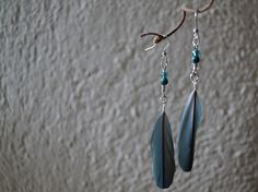 Successful crafting! - Turquoise Parrot Feather Earrings. $11.00, via Etsy.