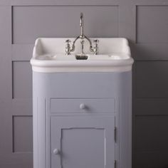 This is an original French 1920's basin on a reproduction cabinet. It is ideal for a children's or small guest bathroom.