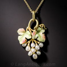 Art Nouveau Pearl Grape Cluster Pendant.  A rare and juicy find for lovers of both vino and Art Nouveau. A lustrous cluster of pearl grapes are crowned by shimmering green and pink enameled leaves in this truly lovely pendant - circa 1900. 1 by 3/4 inch. The new chain measures 18 inches.