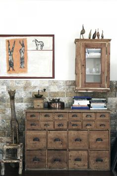 Diy this!large  Bottom drawers and then faux apothecary doors ontop?