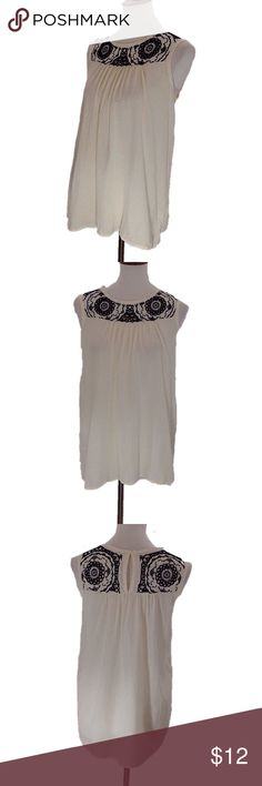 Sleeveless Shirt w/Embroidered Detail Sleeveless shirt with embroidered detailing. Coloring is a yellowish cream with black detailing. Nine 1 Eight Tops Blouses