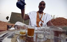 A Sahrawi refugee prepares tea on July 8, 2016 at the Sahrawi refugee camp of Dakhla, 170 kms to the southeast of the Algerian city of Tindouf, in the disputed territory of Western Sahara. Saharawi delegates are expected to elect a new President of the Sahrawi Arab Democratic Republic (SADR) and secretary general of the Polisario Front after the death of the late president Mohamed Abdelaziz. The SADR was declared in 1976 by the Polisario Front -- a rebel movement that wants independence for…