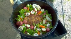 Dutch oven roast with veggies and mushrooms while camping! YUM!