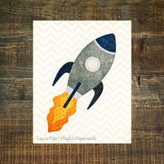 This adorable rocket will add a touch of whimsy to any nursery, playroom or kids room. **FRAME IS NOT INCLUDED.**  I hand-crafted this rocket