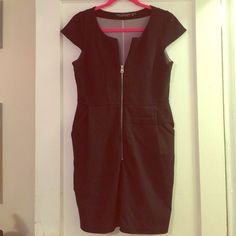 Black Andrew Marc zip up dress. Size 6. Black (stretchy) above knee length dress. Zip up (silver hardware) detail and flattering pockets at hip that add a cool twist to the average LBD. Purple stretchy lining on interior. Short sleeves and flattering neckline. This dress is roomy fits more like an 8. In excellent condition worn twice only for a few hours. Great, classy dress and a steal for what I paid! honestly pictures do not do this justice !! It's beautiful, comfy and most importantly…