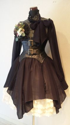 Not exactly my style. Lolita is very pretty, but it's too... elegant? for my tastes. But I would definitely wear TF out of this dress. lol. That corset is HOT. Goth-y.