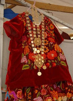 """Huipil With Gold Mexico    The regal looking """"gold"""" necklaces make this huipil and skirt from the Isthmus region of Oaxaca fit for a queen."""