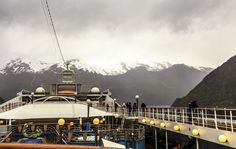 We are sailing very slowly through the narrow fjords close to the rocky coastline.