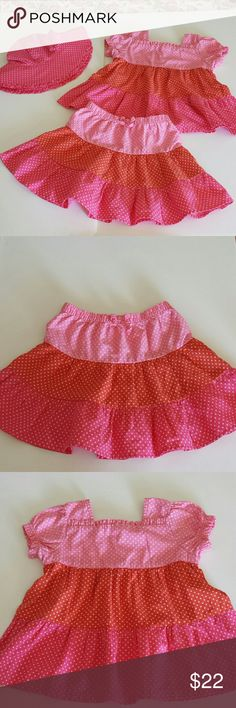 Gymboree Girls Skirt, Blouse and Sunhat Set This set is so adorable in its pretty pink, orange and white polka dots...but each piece is a different size. The skirt is toddler girls size 2T, blouse, toddler girls size 3T and sunhat toddler girls size 4T-5T. Made by Gymboree, 100% cotton, machine wash cold, tumble dry low, warm iron as needed. One of my favorite sets from Gymboree! Gymboree Matching Sets