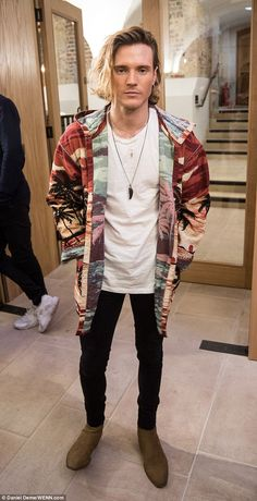 Chic: Dougie Poynter, 28, was a vision of sartorial chicness at the Joshua Kane Bespoke in association with LAB SERIES show in Spitalfields on Friday