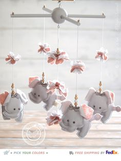 Perfect for the baby girl nursery decor, here I showcase an Elephant Nursery Mobile handcrafted in Italy with European certified fabrics. It help to