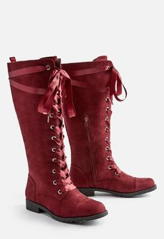 1626a054333 A statement tall boot with a fun satin ribbon lace-up and inner zip closure