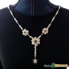 "Tiny puff stitches form a chain of delicate ""beads"" with simple flower embellishments. Easily customizable, this necklace can be a special occasion showpiece, or an everyday wardrobe staple. It's great for gifting and craft fairs too!"