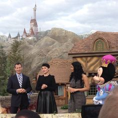 Tom Staggs, Ginnifer Goodwin, Jordin Sparks and Mickey Mouse cutting the ribbon to the #NewFantasyland