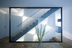 modern house open stairway interior skylight-lit design