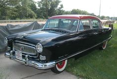 The back of the RKC (resident known criminal) card: 1954 Nash (Ambassador), red and black.