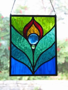 Peacock Feather Stained Glass Suncatcher..My Granddaughter want to learn with this one.