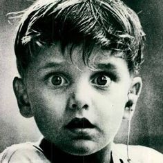 The exact moment 5 year old Harold Whittles hears for the first time with an aid, 1963. Photograph by Jack Bradley.