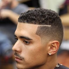 Clean fade with shaved part - curly hair
