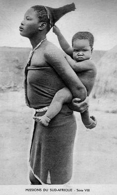 Africa | Zulu woman with a baby on her back. South Africa || Vintage postcard; publisher Mission du Sud-Afrique. Serie VIII