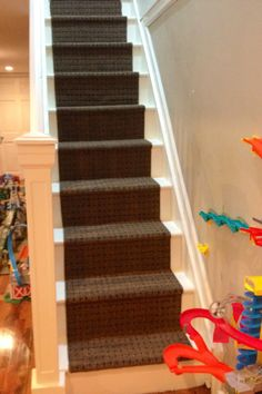 Great use for a 2x6 Runner: DIY stair runner made from 2.5 rubber backed runners from Costco. Cost approximately $30. So when it gets grungy in a couple years or if my boys ruin it I won't mind ripping it up and laying down a new one.