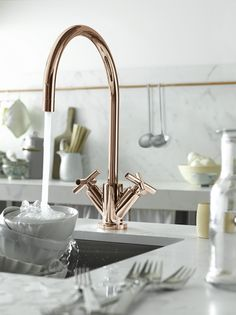 "Classic copper kitchen faucet by Dornbracht (model Cyprum), Design by Sieger Design quote: ""CYPRUM is made of gold and copper and has a very rose-gold superior finish. The name was derived from the Latin word ""Cuprum"" for copper. Copper Faucet, Copper Bath, Deco Rose, Kitchen Fixtures, Kitchen Faucets, Copper Handles Kitchen, Plumbing Fixtures, Küchen Design, Design Ideas"
