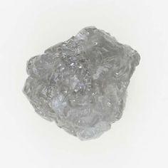 Unique 0.45 TCW Natural Unique Silver Color Rough Standing Diamond