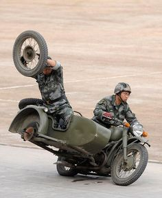 Chinese Army Drill: Practicing changing a tire at 70 mph....