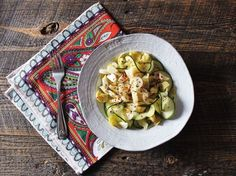 zucchini, artichoke, and hearts of palm salad with red chili pepper flakes and lemon juice