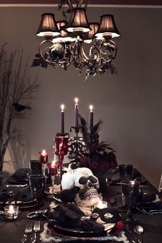 sinister Halloween table decorations black tablecloth black tableware skull candles
