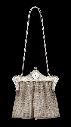 Metal purse with watch built into the frame, circa 1920