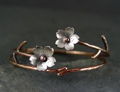 Cherry Blossom Bronze Cuff, Sakura bracelet, Spring Flower Cuff, Gifts for Mom, Gifts for her, Silver Plum Cuff. $52.00, via Etsy.