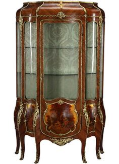 "Circa 1880   Origin: France   Depth: 18″ Width: 44″ Height: 77″   Maker: Unknown   Style: Louis XV   Materials/Techniques: Gilt-bronze and wood   Signed: ""Pasli"" to center painted panel area   Condition: Good Overall Condition. Small nicks to corners, age wear appropriate   The front with a door and five Vernis Martin panels […]"